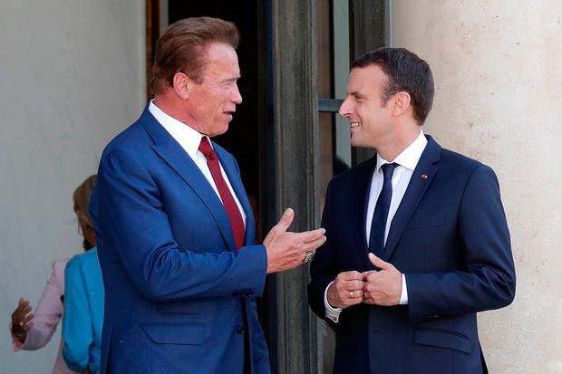 Former California Governor Arnold Schwarzenegger (L) speaks with French President Emmanuel Macron as he leaves after a meeting at the Elysee Palace in Paris, France, June 23, 2017. REUTERS/Charles Platiau