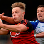 Down's Jerome Johnston holds possession under pressure from Ryan Wylie of Monaghan during the Ulster senior football semi-final match at the Athletic Grounds in Armagh. Photo: Sportsfile