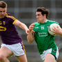 Ger Collins of Limerick in action against Naomhan Rossiter of Wexford during the GAA Football All-Ireland Senior Championship Round 1B match between Limerick and Wexford at the Gaelic Grounds in Limerick. Photo: Sportsfile