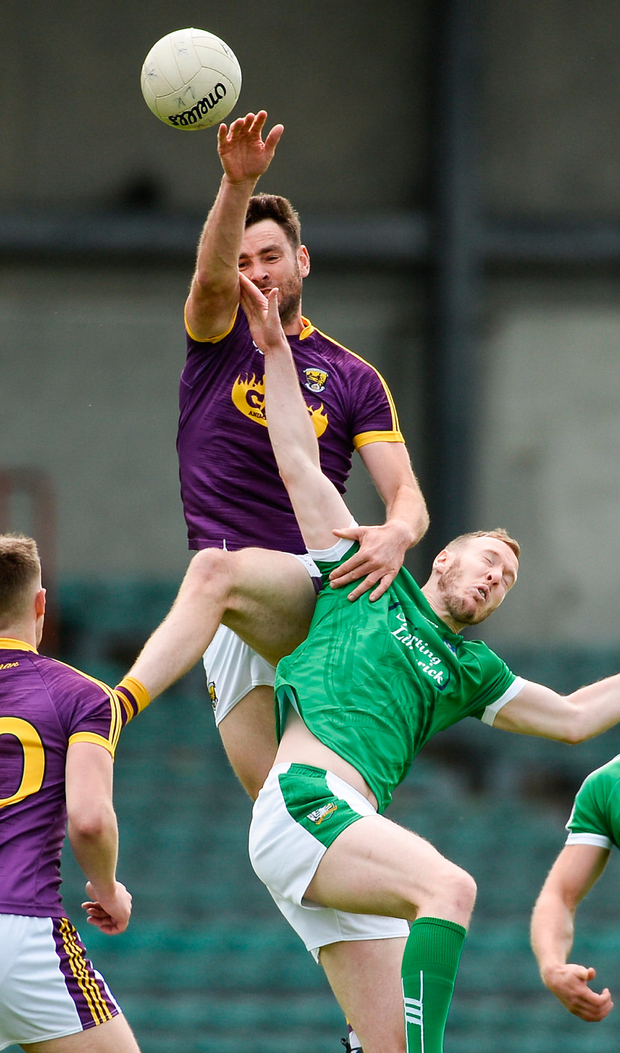 Daithi Waters of Wexford in action against David Ward of Limerick during the GAA Football All-Ireland Senior Championship Round 1B match between Limerick and Wexford at the Gaelic Grounds in Limerick. Photo: Sportsfile