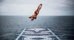 Jonathan Paredes of Mexico dives from the 27.5 metre platform during the first stop of the Red Bull Cliff Diving World Series at the Serpent`s Lair, Inis Mor, Ireland on June 24, 2017.