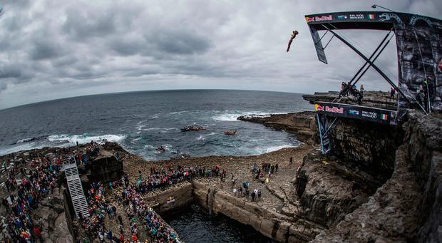 Gary Hunt of the UK dives from the 27.5 metre platform during the first stop of the Red Bull Cliff Diving World Series at the Serpent`s Lair, Inis Mor, Ireland on June 24, 2017.