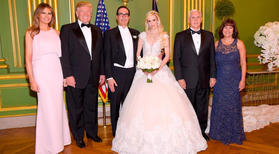 (L-R) First Lady Melania Trump, President Donald Trump, Secretary of the Treasury Steven Mnuchin, Louise Linton, Vice President Mike Pence, and Second Lady Karen Pence pose at the wedding of Secretary of the Treasury Steven Mnuchin and Louise Linton on June 24, 2017 at Andrew Mellon Auditorium in Washington, DC. (Photo by Kevin Mazur/Getty Images for LS)