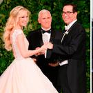 Vice President Mike Pence (C) officiates the wedding of Louise Linton (L) and Secretary of the Treasury Steven Mnuchin, left, and Melania Trump, right