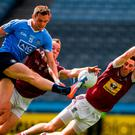 Dean Rock of Dublin has his shot on goal blocked by Ger Egan, right, and Frank Boyle of Westmeath during the Leinster GAA Football Senior Championship Semi-Final match between Dublin and Westmeath at Croke Park in Dublin. Photo by Ray McManus/Sportsfile