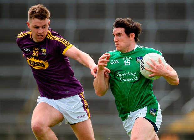 Limerick's Ger Collins in action against Naomhan Rossiter of Wexford during their All-Ireland Senior Championship Round 1B match. Photo: Diarmuid Greene/Sportsfile