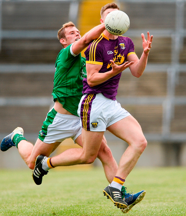 Wexford's Naomhan Rossiter battles with Limerick's Darragh Treacy at the Gaelic Grounds in Limerick. Photo: Diarmuid Greene/Sportsfile