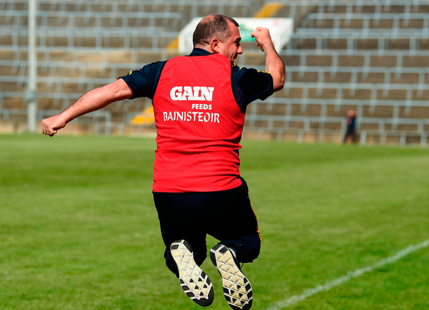 Wexford manager Seamus 'Banty' McEnaney leaps for joy at the final whistle in Limerick. Photo: Diarmuid Greene/Sportsfile