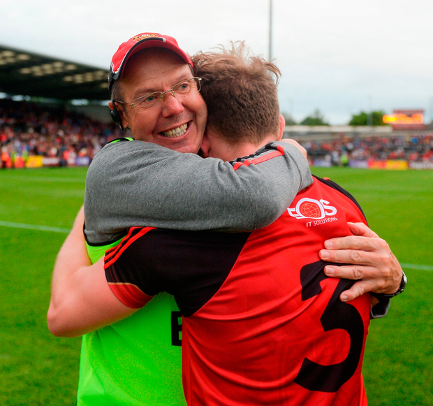 Down manager Eamonn Burns and Gerard McGovern celebrate at the final whistle. Photo: Daire Brennan/Sportsfile