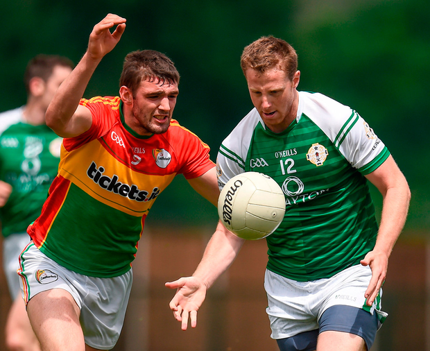 London's Mark Gottsche in action against Seán Murphy of Carlow. Photo: Seb Daly/Sportsfile