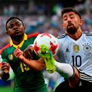 Cameroon's defender Collins Fai challenges Kerem Demirbay during the Confederatons Cup match in Sochi. Photo: Getty Images