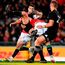 Ben Te'o – seen here tackling Sonny Bill Williams – had an impressive game in his first Test for the Lions. Photo by Stephen McCarthy/Sportsfile