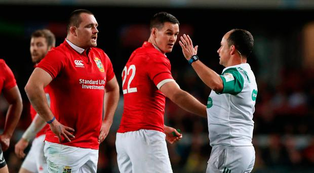 Jonathan Sexton and Ken Owens listen to referee Jaco Peyer. Photo: Getty