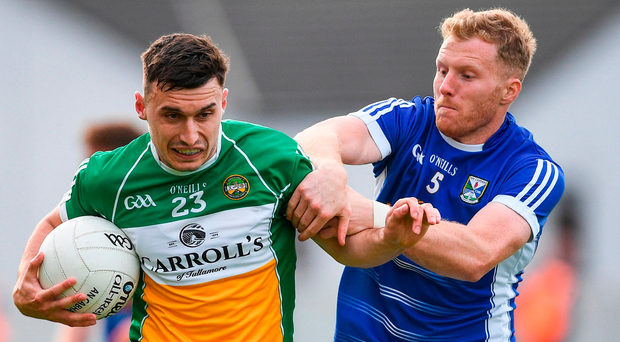Offaly's Sean Doyle is tackled by James McEnroe of Cavan. Photo: Ramsey Cardy/Sportsfile