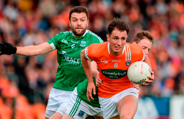 Armagh's Stephen Sheridan in action against Ryan McCluskey of Fermanagh. Photo: Oliver McVeigh/Sportsfile