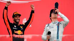 Lance Stroll of Canada takes a celebratory drink from the boot of Daniel Ricciardo as the Australian celebrates his victory in the Azerbaijan Grand Prix in Baku. Photo: Getty Images