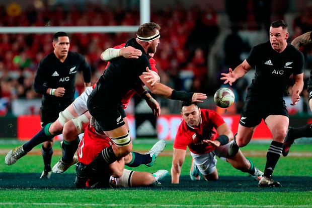 Kieran Read off-loads to Ryan Crotty during New Zealand's victory over the Lions. Photo: Fiona Goodall/Getty Images