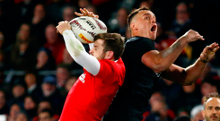 Israel Dagg and Elliot Daly challenge for the ball during New Zealand's victory. Photo: David Gray/Reuters