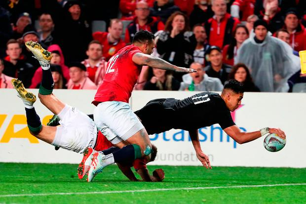 Rieko Ioane goes over to score a try despite the efforts of Ben Te'o and Liam Williams. Photo: Fiona Goodall/Getty Images