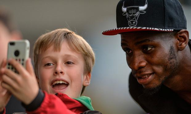 Ismahil Akinade poses for a selfie with a young supporter last year; The Bohs player has managed to overcome a possibly career-ending condition. SPORTSFILE