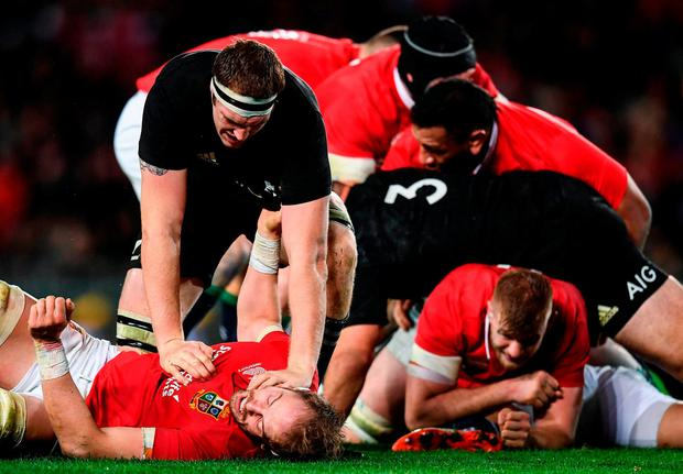 New Zealand's Brodie Retallick holds down Alun Wyn Jones. SPORTSFILE