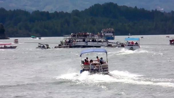 A ferry sinks in the Guatape reservoir near Medellin, Colombia in this still image taken from video obtained from social media. REUTERS