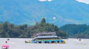 A tourist ferry sinks in the Guatape reservoir in Colombia in this still image taken from video obtained from social media. Juan Quiroz/via REUTERS.