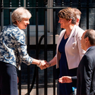 Prime Minister Theresa May greets DUP leader Arlene Foster, DUP deputy leader Nigel Dodds and DUP MP Sir Jeffrey Donaldson outside 10 Downing Street in London ahead of talks aimed at finalising a deal to prop up the minority Conservative Government. Photo: Dominic Lipinski/PA Wire