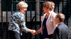 British Prime Minister Theresa May greets DUP leader Arlene Foster outside 10 Downing Street in London yesterday. Photo: PA