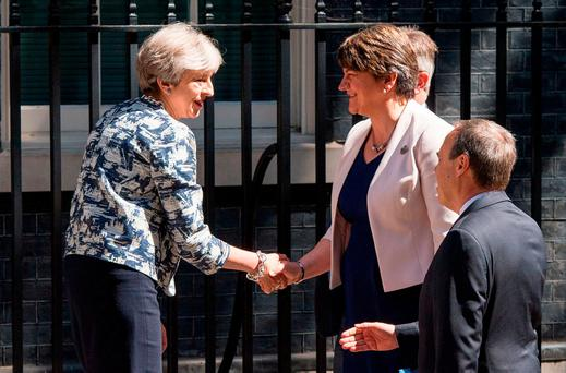 British Prime Minister Theresa May greets DUP leader Arlene Foster outside 10 Downing Street in London Photo: PA