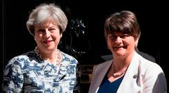 Britain's Prime Minister, Theresa May (L), greets Arlene Foster, the leader of Northern Ireland's Democratic Unionist Party at 10 Downing Street, London. Photo: GETTY