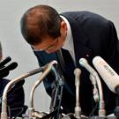Takata CEO Shigehisa Takada bows as he attends a press conference in Tokyo