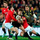 Jordie Barrett of the Hurricanes is tackled by Robbie Henshaw and Rory Best