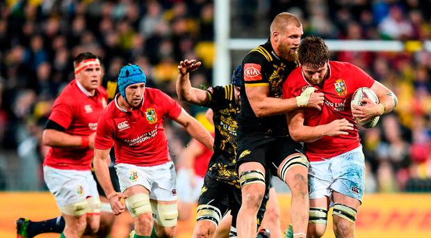 Iain Henderson of the British & Irish Lions is tackled by Brad Shields of the Hurricanes during the match between Hurricanes and the British & Irish Lions at Westpac Stadium in Wellington, New Zealand. Photo by Stephen McCarthy/Sportsfile