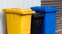 Under a new system flat rate fees will be banned, meaning households which only use the black bin to dispose of waste will pay higher charges (Stock photo)