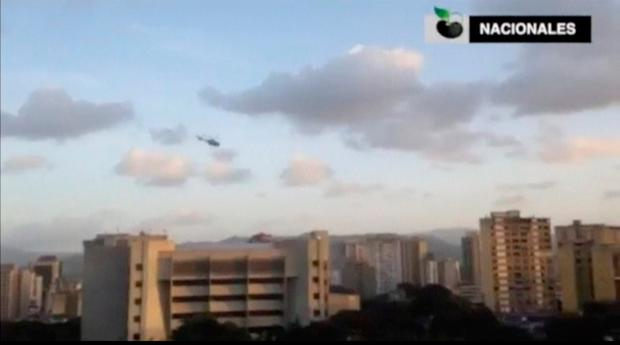 A police helicopter flies over Venezuela's Supreme Court building in Caracas June 27, 2017, in this still image taken from a video (Credit: Caraota Digital)