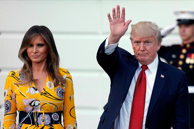 U.S. President Donald Trump and First Lady Melania Trump wave as India's Prime Minister Narendra Modi leaves the White House after a visit, in Washington, U.S., June 26, 2017. REUTERS/Carlos Barria
