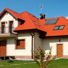 Soak up the sun: Use solar panels on your roof to cut your water heating bills. Stock photo