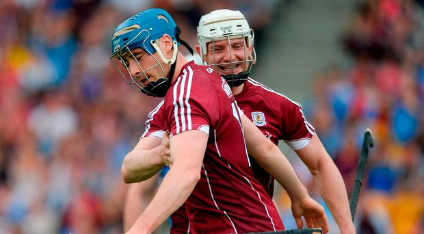 Joe Canning congratulates Conor Cooney (L) after his goal against Dublin in the Leinster SHC quarter-final in Tullamore. Photo by Daire Brennan/Sportsfile
