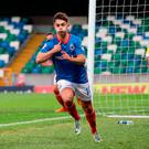Jordan Stewart celebrates after scoring Linfield's last-minute winner against La Fiorita in the first leg of their Champions League tie at Windsor Park. Photo credit: Niall Carson/PA Wire