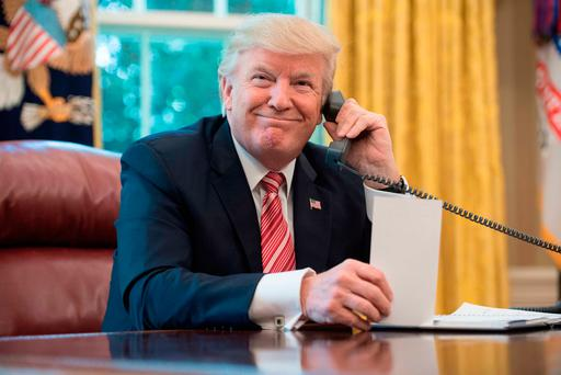 US President Donald Trump waits to speak on the phone with Taoiseach Leo Varadkar to congratulate him on his recent election victory. Photo: AFP/Getty Images