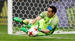 Chile's Claudio Bravo saves from Portugal's Nani to win the penalty shootout. Photo: Reuters