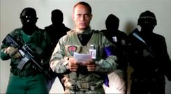 Investigative police pilot Oscar Perez reading a statement from an undisclosed location. Photo: Reuters