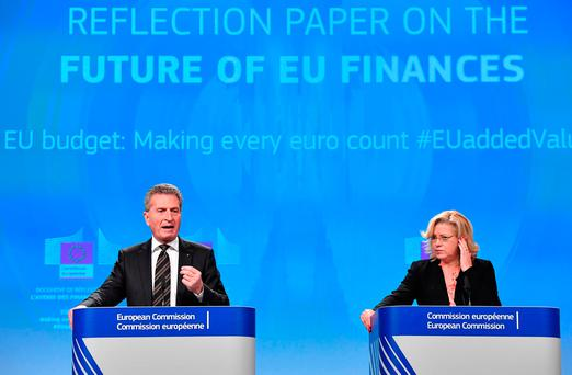 German EU Commissioner for budget and human resources Gunther Oettinger (L) and Commissioner for regional policy Corina Cretu address a press conference on the future of the EU Budget at the European commission in Brussels. Photo: AFP/Getty Images