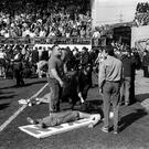 Fans lie on advertising boards which were used as makeshift stretchers. Photo credit: PA/PA Wire