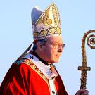 In this July 15, 2008, file photo, Cardinal George Pell walks onto the stage for the opening mass for World Youth Day in Sydney, Australia (AP Photo/Rick Rycroft, File)