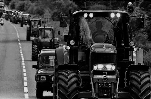 The driver of the car was 'blinded by the sun' and hit the tractor.