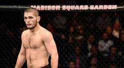 Khabib Nurmagomedov of Russia looks on against Michael Johnson of the United States in their lightweight bout during the UFC 205 event at Madison Square Garden on November 12, 2016 in New York City. (Photo by Jeff Bottari/Zuffa LLC/Zuffa LLC via Getty Images)