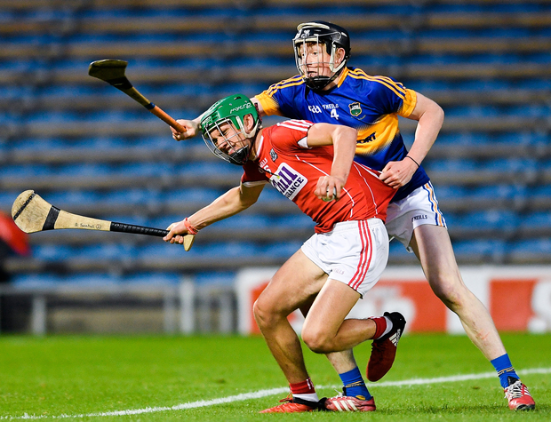 Brian Turnbull of Cork in action against Jerome Cahill of Tipperary during the Electric Ireland Munster GAA Hurling Minor Championship Semi-Final match between Tipperary and Cork at Semple Stadium in Thurles, Co Tipperary. Photo: Sportsfile