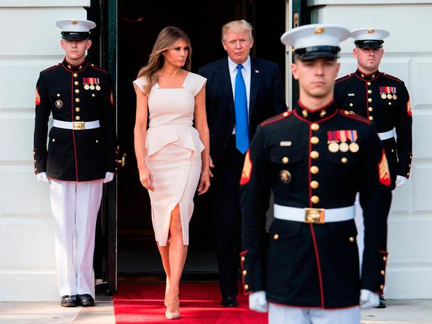 US President Donald Trump and First Lady Melania Trump walk out to receive South Korean President Moon Jae-in and his wife Kim Jeong-suk at the White House in Washington, DC, on June 29, 2017. / AFP PHOTO / NICHOLAS KAMMNICHOLAS KAMM/AFP/Getty Images